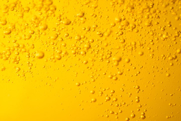 Motion of bubble oil liquid or beer  juice syrup yellow color for background