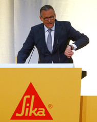 Haelg, chairman of the board of Swiss chemicals group Sika addresses the company's annual shareholder meeting in Baar