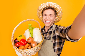 Onion pepper cabbage carrot lattice salad ingredients recipe modern technology internet roaming video-call concept. Close up portrait of funny joyful seller taking selfie isolated on background