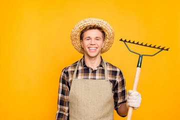 Cleanup people person rustic lifestyle concept. Close up portrait of glad confident excited cheerful rejoicing gardener using hand tool for getting rid of leaves isolated  on background copy-space