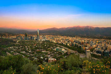 View of Santiago de Chile with Los Andes mountain Range in the back at sunset