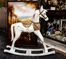 Vintage rocking horse in front of old toy shop