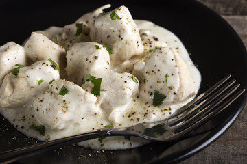 Chicken meat with sour cream and herbs