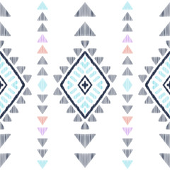 Ethnic seamless pattern for modern home decor. Tribal graphic design. Textured geometric shape in a black, blue, pink, orange and white palette. American indian navajo rug.
