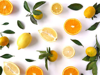 Fototapete - Food pattern of fresh fruit in a cut. Oranges, lemons slices , tangerines with green leaves. Composition from fruits, top view, flat lay. Citrus fruits background, wallpaper.