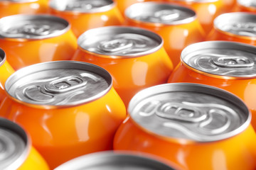 Orange soft drink cans. Macro shot