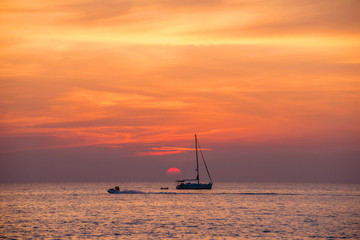 Tropical sunset on the beach,Sunset with yacht ,Beautiful Seascape