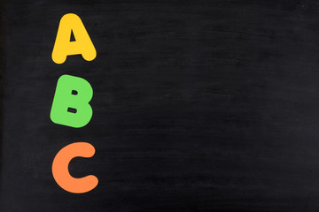 blackboard with letters abc educational background