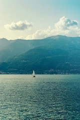 White sailboat on lake Como - View from Bellano, Italy
