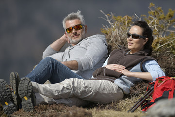 Hikers relaxing in the mountains during journey