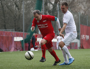 Russian Deputy Prime Minister Dvorkovich takes part in a soccer match, as part of the campaign to struggle against the AIDS epidemic and discrimination, in Moscow