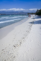 couple walking gili trawangan beach indonesia