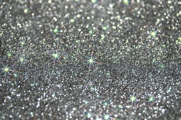 beautiful festive silver shiny background with bright sparks and shimmering stars and circles