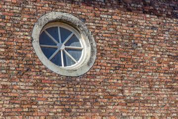 Circular Window in brick wall
