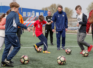 Crooks from Irish football association and Dornan from Newcastle United Foundation take part in a practise session of a seminar organised by the FC Shakhtar Donetsk, for soccer training for children with disabilities, near Kiev