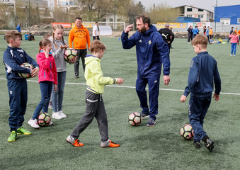 Crooks from Irish football association takes part in a practise session of a seminar organised by the FC Shakhtar Donetsk, for soccer training for children with disabilities, near Kiev