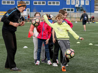 A boy kicks a ball during a practise session of a seminar organised by the FC Shakhtar Donetsk, for soccer training for children with disabilities, near Kiev