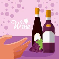 Hand grabbing wine bottles