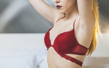 blonde girl with red lingerie at hotel room
