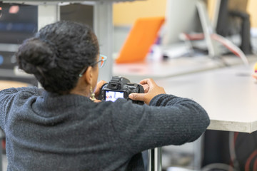 A close up of African American woman with her camera