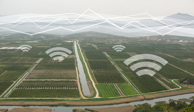 Top view of agricultural land. Valley of fields with irrigation system and wireless control. Internet of things in agriculture
