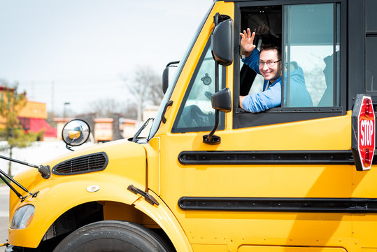 School bus driver waving out window