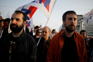 Greek Communist Party supporters demonstrate against recent air strikes on Syria by the United States, Britain and France, in Athens