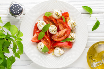 Italian fresh tomato Caprese salad, mozzarella and Basil