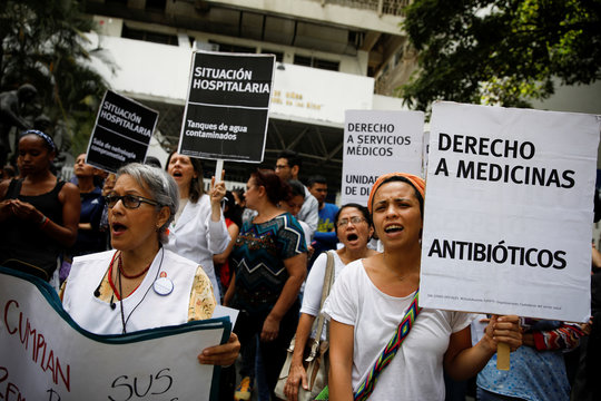 Workers of the health sector take part in a protest, due to the shortages of basic medical supplies and for higher wages, outside a children hospital in Caracas