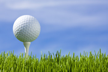 Golf ball on a blue sky (horizontal)
