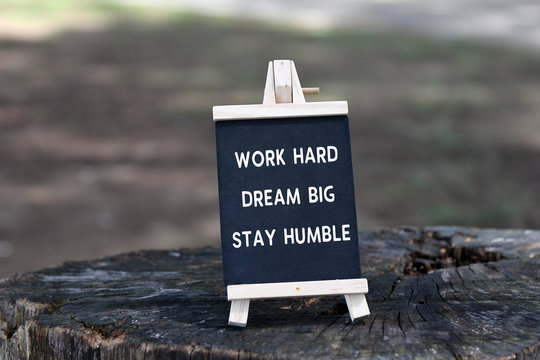 Inspirational quote - Work hard, dream big, stay humble, on black board.