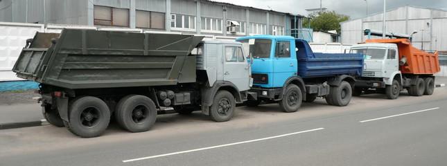grey, blue and orange trucks