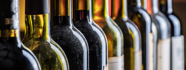 Acrylic Prints Bar Line of wine bottles. Close-up.