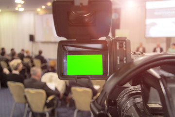 Digital video camera recording event. Business conference or seminar