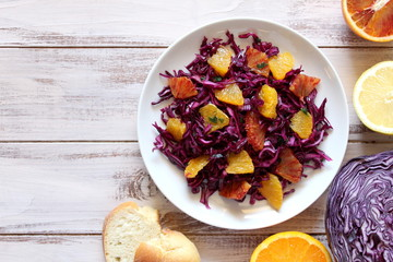 Vegetarian and vegan dish. Red cabbage with orange. Top view.