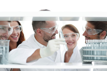 closeup of a doctor-pharmacists and colleagues working in the laboratory.