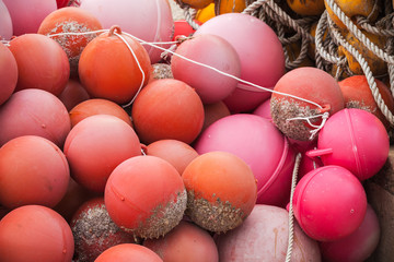 Red spherical plastic floats of fishing nets