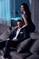 Smart couple in a luxurious hotel's apartment