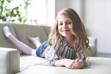 sweet cute and beautiful 10 years child on sofa