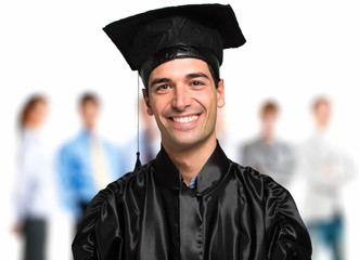 Happy graduated student smiling