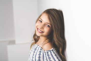 Portrait of 9 years old girl, isolated on gray