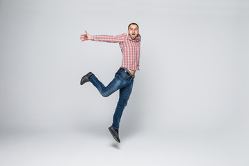 Handsome young man jumping isolated on white background