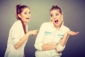 Two girls having argument, interpersonal conflict