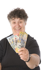 A happy senior woman showing money, focus on the money.