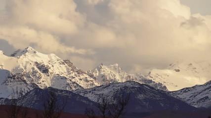 Wall Mural - Clouds Roll Over High Peaks Alaska Mountain Range