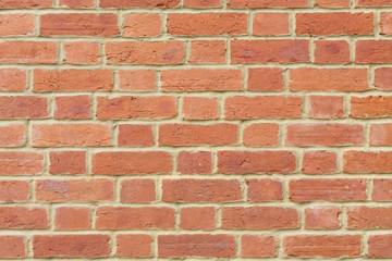 Red brick wall background closeup