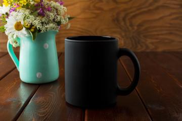 Black coffee mug rustic mockup with wildflowers in mint green vase
