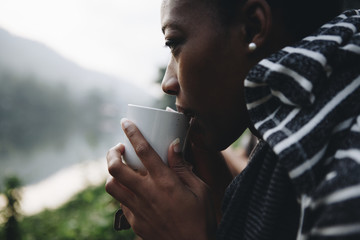 Woman enjoying morning coffee in nature