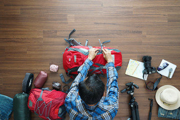 Overhead view of traveler man plan and backpack planning vacation travel idea concept trip. Top view.