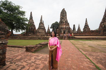 Beautiful women wearing thai dress in ancient temple